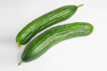 Fresh green cucumber isolated on white background