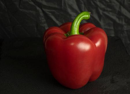Fresh red sweet bulgarian pepper isolated on black background Imagens