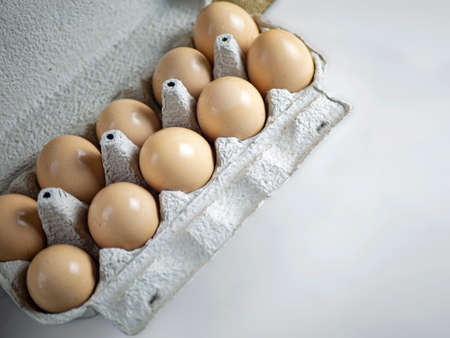 paper box with farm fresh chicken eggs on white background