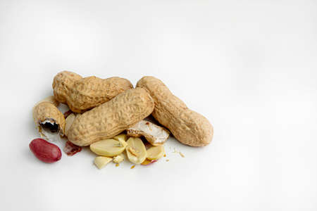 Handful of the raw peanuts on white background