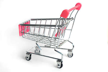 Shopping cart isolated on white background. Business concept. Imagens
