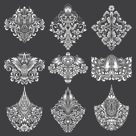 Set of ornamental elements for design. White floral decorations on black. Isolated tattoo patterns in vintage baroque style. Illustration