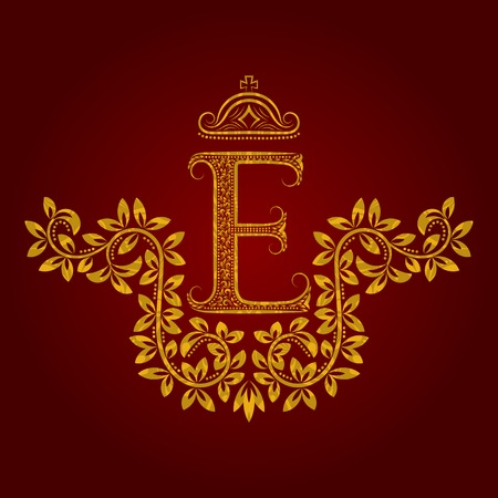 Patterned golden letter E monogram in vintage style. Heraldic coat of arms. Baroque template.