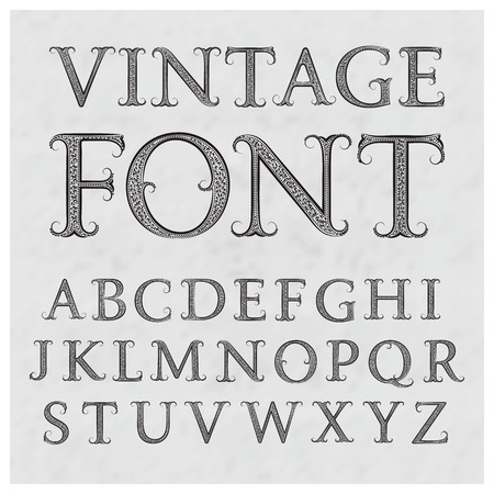 Vintage patterned letters. Vintage font in floral baroque style. Vintage latin alphabet. Vintage black capital letters on a gray textured background.