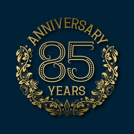 fifth: Golden emblem of eighty fifth years anniversary. Celebration patterned logotype with shadow on blue.