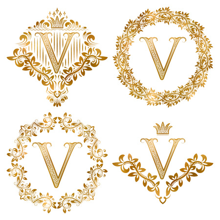 Golden V letter vintage monograms set. Heraldic coats of arms and round frames.