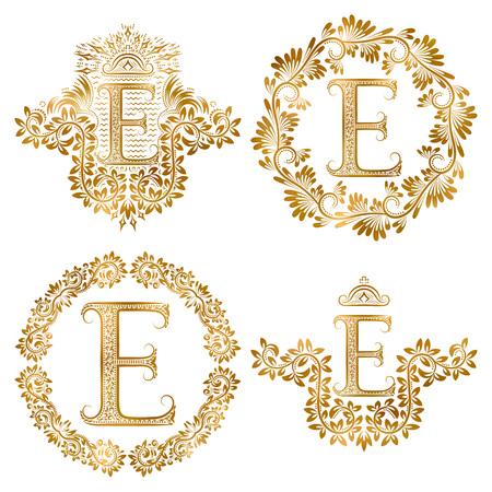 Ensemble de monogrammes vintage lettre dorée E. Monogramme héraldique en forme de blason, lettre E en cadre rond floral, lettre E en couronne, monogramme héraldique en décor floral avec couronne.