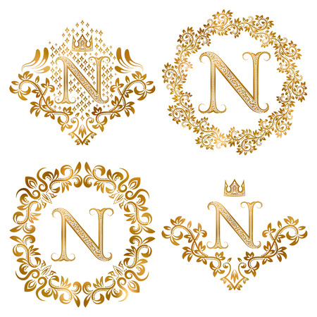 Golden letter N vintage monograms set. Heraldic monogram in coats of arms form, letter N in floral round frame, letter N in wreath, heraldic monogram in floral decoration with crown. Ilustração