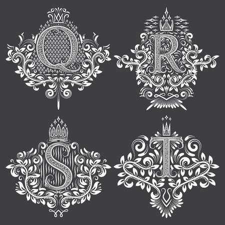 Set heraldische monogrammen in wapenschilden vorm. Witte bloemen decoratieve zegels op zwart. Geïsoleerde tatoegeringsetiketten in uitstekende barokke stijl.