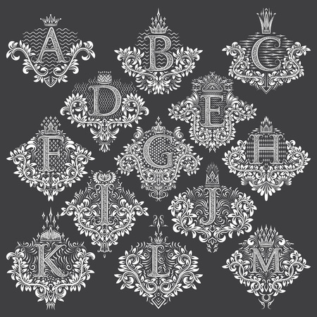 Set of heraldic monograms in coats of arms form. White floral decorative stamps of letters from A to M. Isolated tattoo labels in vintage baroque style. Stock fotó - 94747415