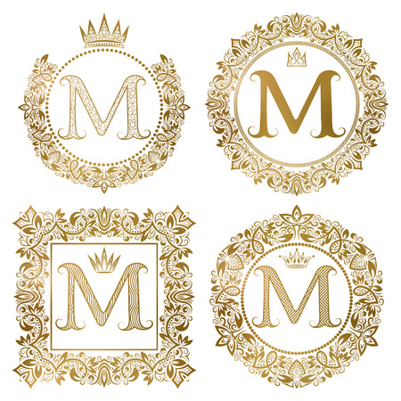 Golden letter M vintage monograms set. Heraldic coats of arms, round and square frames.
