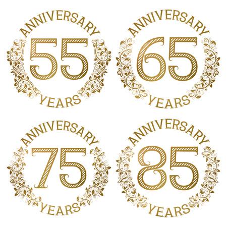 Ensemble d'emblèmes d'anniversaire d'or. Cinquante-cinquième, soixante-cinquième, soixante-quinzième, quatre-vingt-cinq ans signe dans un style vintage.