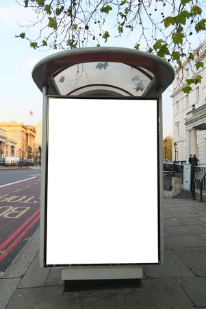 billboard posting: Bus stop close to Hyde Park Corner Station in central London, United Kingdom. This is for advertisers to place ad copy samples on a bus shelter.  Stock Photo