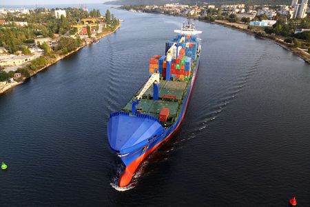 VARNA, BULGARIA - SEPTEMBER 26: Turkish cargo ship HILDE A (Year Built: 2005, DeadWeight: 22033 t) sails into Port of Varna-West to be loaded with containers on September 26, 2010 in Varna, Bulgaria. Editorial