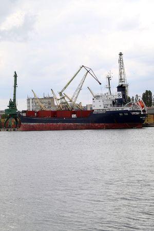 good bey: VARNA, BULGARIA - OCTOBER 03: Cargo ship MEHMET BEY (Year Built: 2000, Flag: St Kitts Nevis) is loaded with 4900 tones of sunflower seed in Port of Varna-East on October 03, 2010 in Varna, Bulgaria.