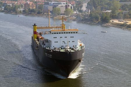 VARNA, BULGARIA - SEPTEMBER 19: Bulgarian cargo ship GEROITE NA ODESSA (Year Built: 1978, DeadWeight: 12900 t) sails to a special ferry terminal on September 19, 2010 in Varna, Bulgaria. Stock Photo - 8151453
