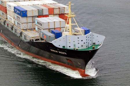 VARNA, BULGARIA - DECEMBER 14: Cargo ship WARNOW VAQUITA (Year Built: 2008) sails into open sea on December 14, 2010 in Varna, Bulgaria. Ship`s next destination is Constanta, Romania. Stock Photo - 8448694