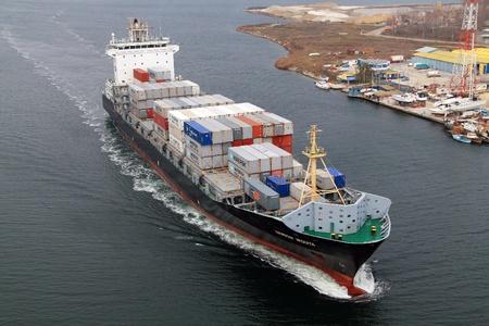 VARNA, BULGARIA - DECEMBER 14: Cargo ship WARNOW VAQUITA (Year Built: 2008) sails into open sea on December 14, 2010 in Varna, Bulgaria. Ship`s next destination is Constanta, Romania.