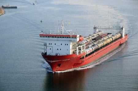 VARNA, BULGARIA - JANUARY 5: Cargo ship AVANGARD (Flag: Cambodia, IMO: 9522403) sails to a special ferry terminal on January 5, 2011 in Varna, Bulgaria.