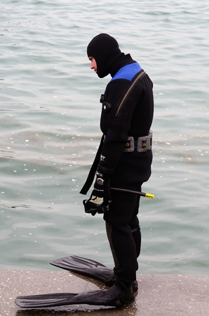 lieutenant: VARNA, BULGARIA - JANUARY 6: Eastern Orthodox Church honors Epiphany on January 6, 2011 in Varna, Bulgaria. Lieutenant Boyan Dobrevs Diving command was on duty to ensure the safety of the event.