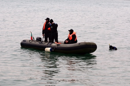 to ensure: VARNA, BULGARIA - JANUARY 6: Eastern Orthodox Church honors Epiphany on January 6, 2011 in Varna, Bulgaria. Lieutenant Boyan Dobrevs Diving command was on duty to ensure the safety of the event.