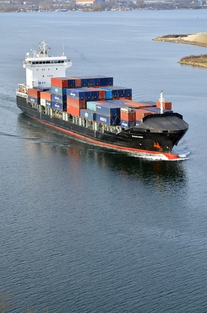 VARNA, BULGARIA - JANUARY 20: Cargo ship DS BLUE OCEAN (Flag: United Kingdom, IMO: 9341976) sails into open sea on January 20, 2011 in Varna, Bulgaria. Ship`s next destination is Island of Malta.  Stock Photo - 8706916