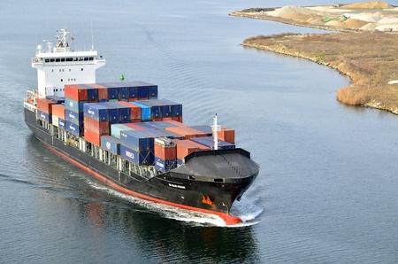 VARNA, BULGARIA - JANUARY 20: Cargo ship DS BLUE OCEAN (Flag: United Kingdom, IMO: 9341976) sails into open sea on January 20, 2011 in Varna, Bulgaria. Ship`s next destination is Island of Malta.  Stock Photo - 8706913