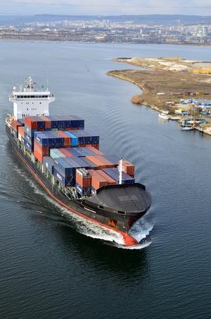 VARNA, BULGARIA - JANUARY 20: Cargo ship DS BLUE OCEAN (Flag: United Kingdom, IMO: 9341976) sails into open sea on January 20, 2011 in Varna, Bulgaria. Ship`s next destination is Island of Malta.  Stock Photo - 8706912