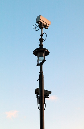 metal post: Surveillance Cameras mounted on a metal post Stock Photo