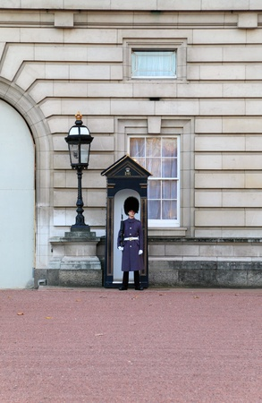 LONDON - NOVEMBER 17: Sentry of the Grenadier Guards in winter uniform posted outside of Buckingham Palace on November 17, 2009 in London, UK.