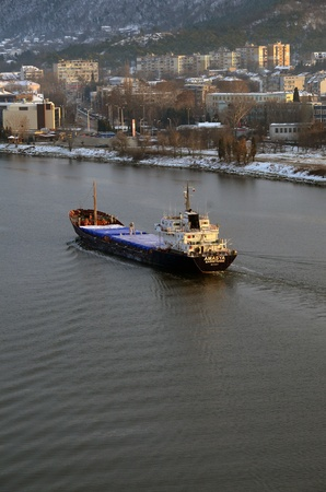 tonnes: VARNA, BULGARIA - JANUARY 26: Cargo ship AMASYA (Flag: St Kitts Nevis, Year Built: 1974) sails into open sea after being loaded with 3400 tonnes of heavy soda on January 26, 2011 in Varna, Bulgaria. Editorial