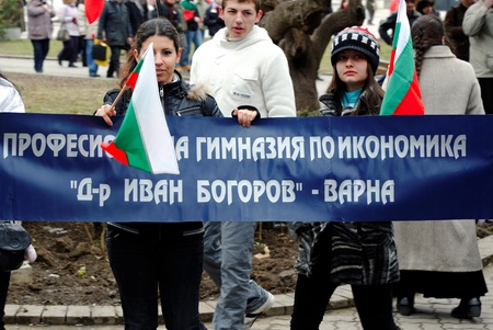 common people: VARNA, BULGARIA - MARCH 3: Officials, military personal and common people are taking part in the Liberation Day celebrations on March 3, 2011 in Varna, Bulgaria.