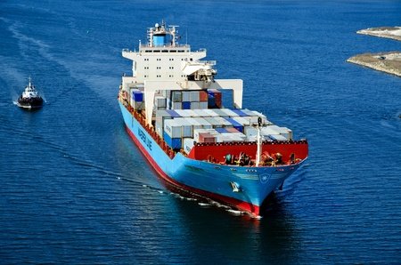 VARNA, BULGARIA-MAR 24: Cargo ship MAERSK TRAPANI (Year Built: 1990, Dead Weight: 21238 t) sails away into open sea after a short stay in Varna-west port on March 24, 2011 in Varna, Bulgaria