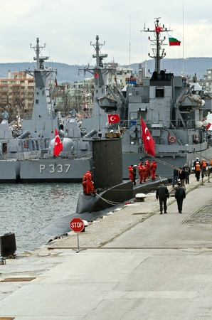 VARNA, BULGARIA - APR 08: Crew members stand on board the Turkish submarine DOLUNAY (S-352) on April 08, 2011 in Varna, Bulgaria. The vessel is taking part in Starfish 2011 Naval exercise. Stock Photo - 9322761