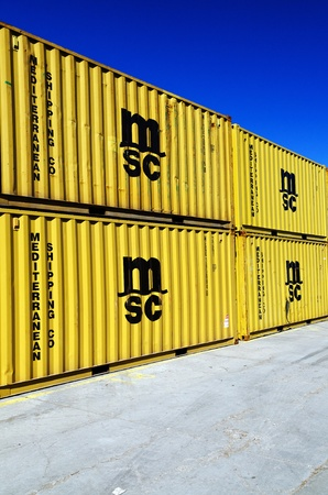 VARNA, BULGARIA - APR 22: Freight containers at the docks in Port of Varna ready for shipping on April 22, 2010 in Varna, Bulgaria. Most of the containers are owned by Mediterranean Shipping Company. Stock Photo - 9475161