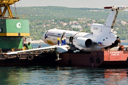 VARNA, BULGARIA - MAY 25: Submerging operation of the former government aircraft on May 25, 2011 in Varna, Bulgaria. Final check of the ropes.