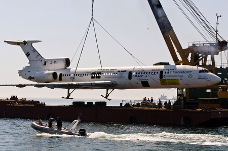 VARNA, BULGARIA - MAY 25: Submerging operation of the former government aircraft on May 25, 2011 in Varna, Bulgaria. The plane is to become large artificial reef, tourist and diving attraction.