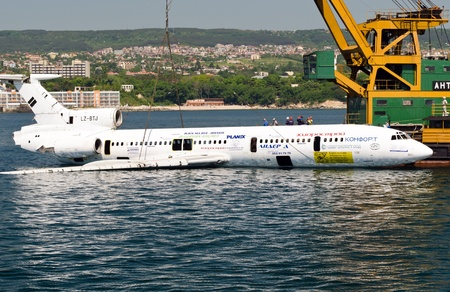 submerging: VARNA, BULGARIA - MAY 25: Submerging operation of the former government aircraft on May 25, 2011 in Varna, Bulgaria. The plane is to become large artificial reef, tourist and diving attraction.