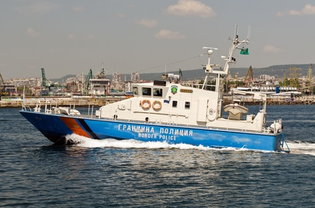 submerging: VARNA, BULGARIA - MAY 25: Bulgarian border police vessel sails back to her base on May 25, 2011 in Varna, Bulgaria. Her mission was to secure the submerging of the TU-154 former government aircraft.