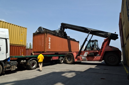 VARNA, BULGARIA - MAY 12: Forklift truck moves containers on May 12, 2011 in Varna, Bulgaria. The market share of processed containers in Port of Varna in the Black Sea region had fallen below 6 %.  Editorial