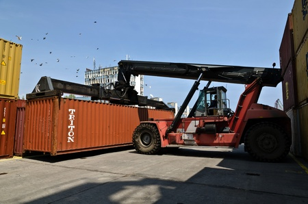VARNA, BULGARIA - MAY 12: Forklift truck moves containers on May 12, 2011 in Varna, Bulgaria. The market share of processed containers in Port of Varna in the Black Sea region had fallen below 6 %.