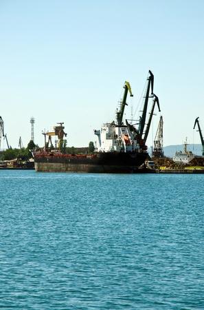 VARNA, BULGARIA - JUNE 07: Cargo ship MICHELLE 1 (Flag: Malta, IMO: 9516246) moored in Port of Varna and loaded with wheat on June 07, 2011 in Varna, Bulgaria.  Editöryel
