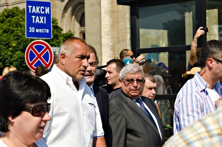 marchers: VARNA, BULGARIA - Since 1933, the Varna City Day is celebrated on August 15, 2011 in Varna, Bulgaria. Among the marchers is the Bulgarian Prime Minister Boyko Borisov (second left, with white shirt).