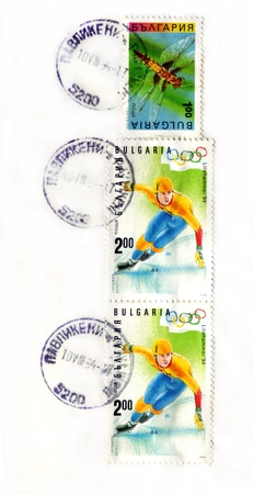 BULGARIA - CIRCA 1993 ind 1994: Three stamps printed in Bulgaria shows insect and skater. The two identical stamps are dedicated to the XVII Olympic Winter Games in Lillehammer, circa 1993 and 1994. Stock Photo - 12059532