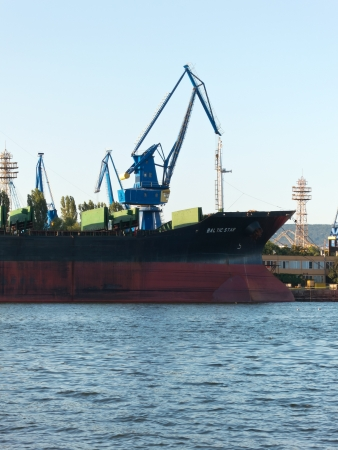 VARNA, BULGARIA - JULY 21: Bulk carrier BALTIC STAR, Flag: Bulgaria, Year Built: 1985, is loaded with goods on July 21, 2012 in Varna, Bulgaria.