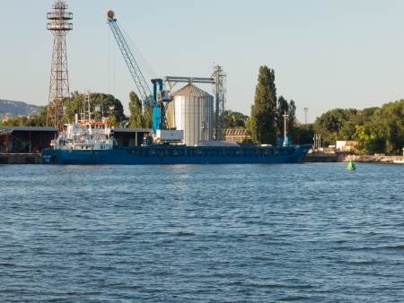 VARNA, BULGARIA - JULY 21: Cargo ship HELEN ANNA, Flag: Antigua Barbuda, Year Built: 2010, is loaded with goods on July 21, 2012 in Varna, Bulgaria. Editorial