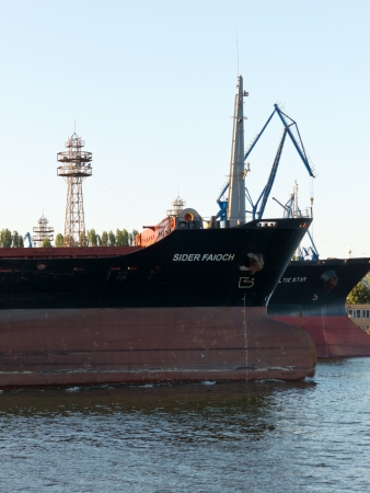 VARNA, BULGARIA - JULY 21: Bulk carrier SIDER FAIOCH, Flag: Italy, Year Built: 1986, sails into open sea on July 21, 2012 in Varna, Bulgaria. Ship`s next destination is Taman, Russia.