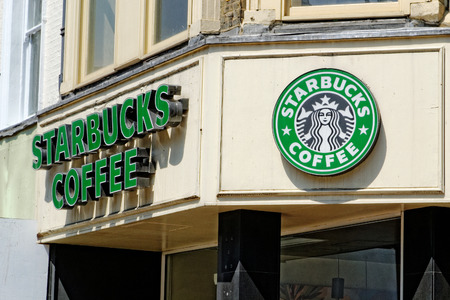 famous industries: London, England - July 1, 2014: Exterior of a Starbucks coffee shop in London, England. Starbucks is the largest coffeehouse company in the world, with stores in 62 countries. Editorial