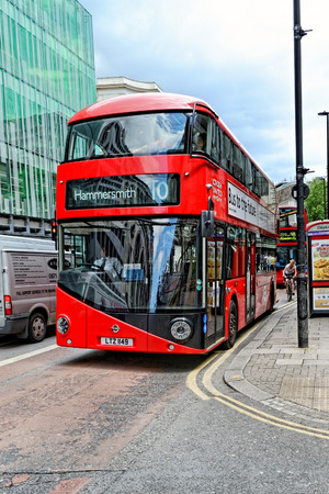 route master bus: LONDON - JULY 1, 2014. The hybrid New Bus For London is now in service on several London bus routes. It is 50% more fuel efficient than existing diesel buses.