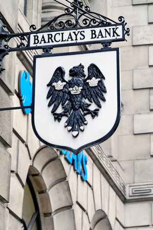LONDON - JULY 1, 2014: Vintage sign of Barclays bank branch in the City of London. Barclays was founded in 1690 and currently employs 146,100 staff (2011).